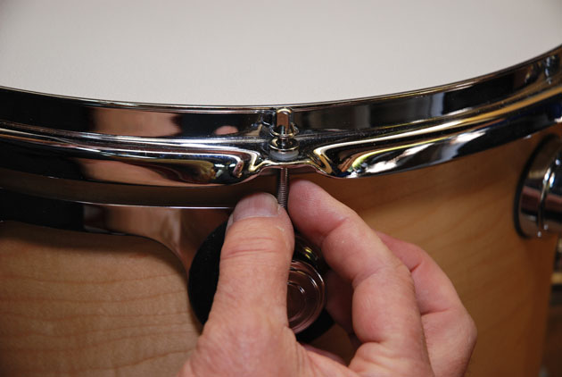 how to change drum heads by setting counter hoops