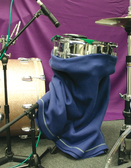 Wrapping the bottom of the snare to reduce bleed into the bottom mike