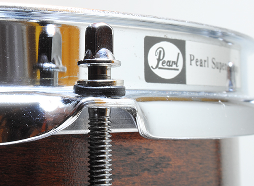 Nylon washer between hoop and metal tension