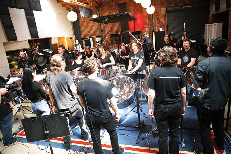 Steelpannists in recording studio