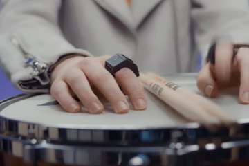 Wave midi triggering ring on finger with drumsticks and snare