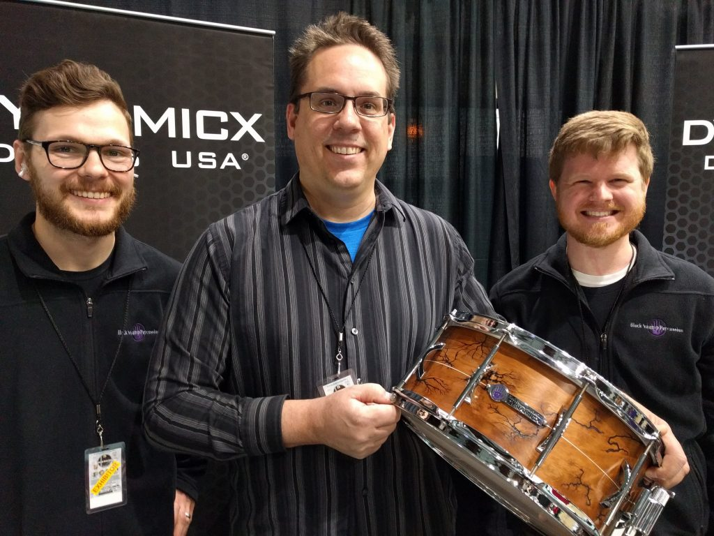 Black Swamp president Eric Sooy, center, with employees at the 2018 Chicago Drum Show