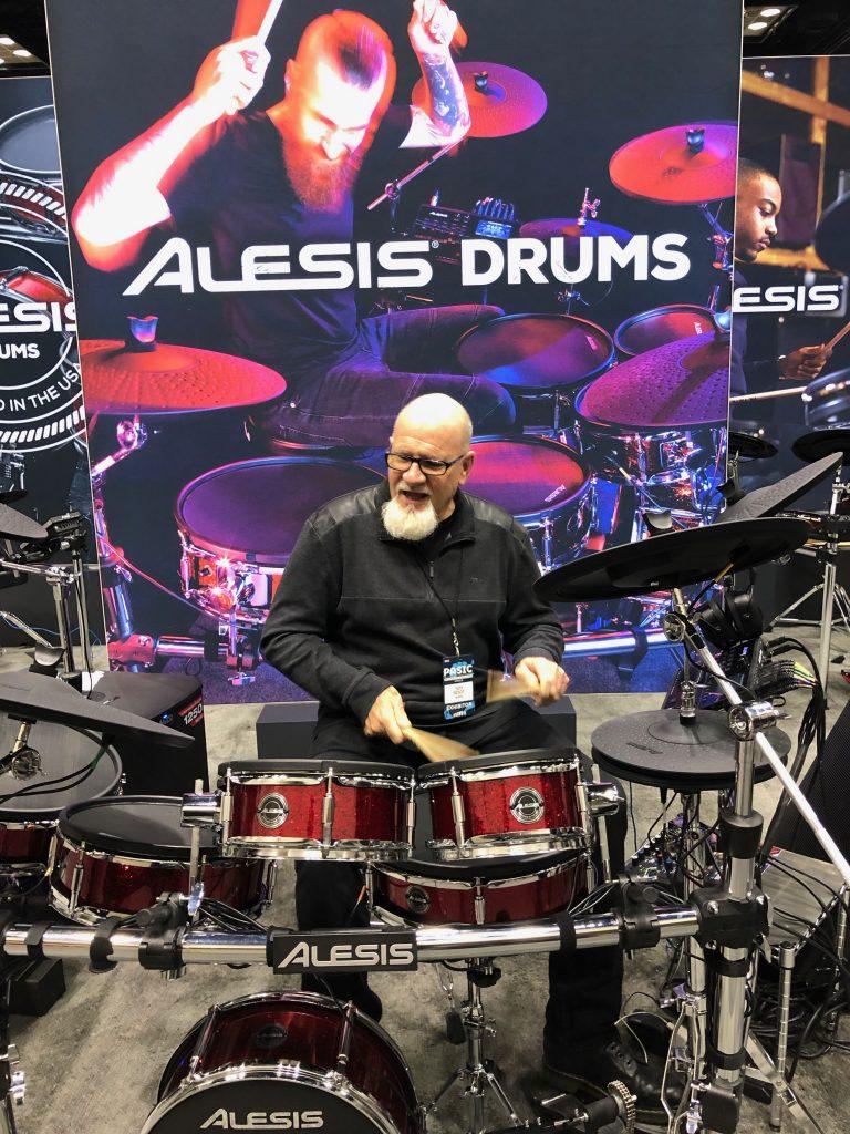 Tim Root demonstrates an Alesis Strike electronic drum set at PASIC in November 2018.
