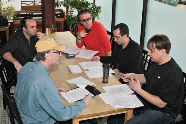 Paul Siegel, Carlock, Joe Bergamini, Rob Wallis, working on the script