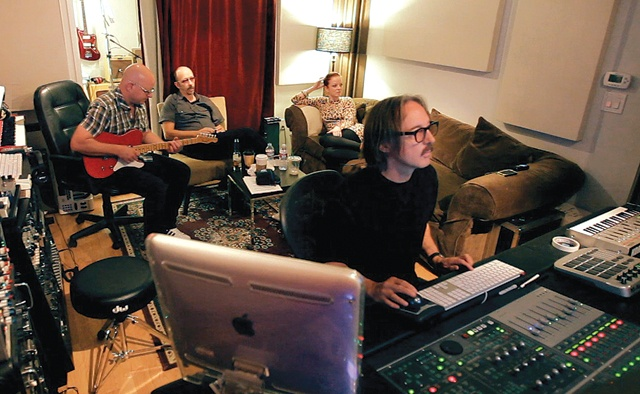 Butch Vig with his team working in the studio