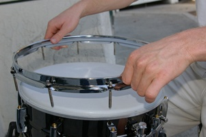 Removing tension rods of the drum