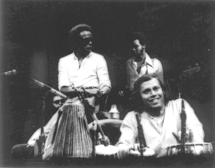 Badal Roy onstage with Miles Davis